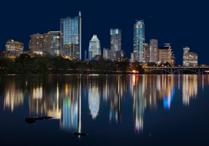 Austin Texas skyline reflects in the water of the Colorado River in 2014.