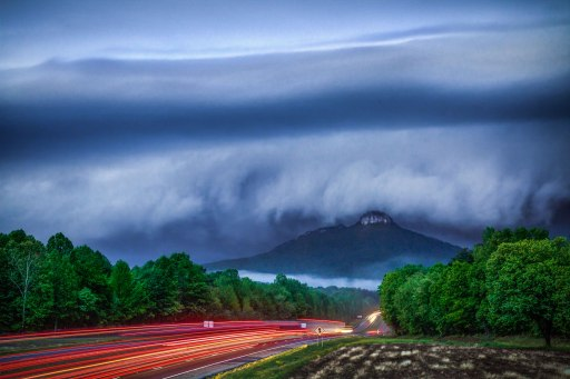 Long exposure of a shelf cloud overtaking Pilot Mountain, in NC. This severe warned storm packed a punch with fast wind, lightning, and hail. Single 4 second exposure @ F/9. From early May 2016.