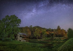 View of the Milky Way above an old barn and the cliffs of Hanging Rock, in NC. The history of this area is lengthy and incredible, due to the mountain serving as one of the earliest land markers of the East Coast. I can only imagine the people who have seen the Milky Way here before me. 2016