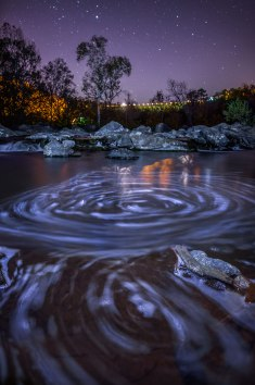 Swirls and stars of the Yadkin River from within the Uwharrie Wilderness in North Carolina. Light painting for the foreground and a 3 image focus stack for sharpness.