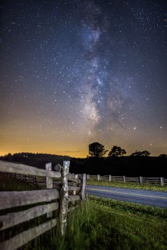 Wooden fences, the Blue Ridge Parkway, and the Milky Way overhead. From the Blue Ridge Mountains north of Boone, NC. Single 30 second exposure, light-painted with my headlamp.
