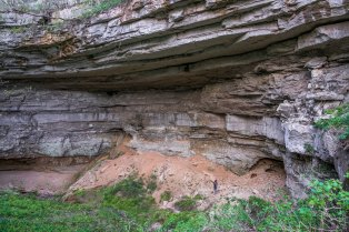 A large capstone feature is viewed from a sinkhole at Cedar Sink Trail, at Mammoth Cave National Park in Kentucky. 2017.