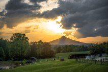 Evening light and crepuscular rays above Pilot Mountain.