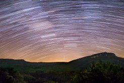 Star trails above Moore's Knob and Hanging Rock, with a meteor in the middle. 2017