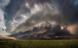 A powerful supercell rotates over an Oklahoma farm while moving toward the camera, in Waurika Oklahoma, in May 2014. This image has been recognized and published by the US State Department for international conversation regarding climate change.