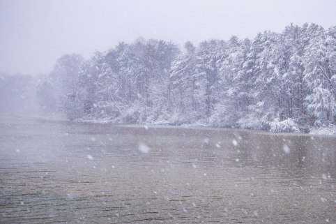 Snow blowing across Lake Higgins, captured following inches of snow. Lake Higgins is between Summerfield and Greensboro in NC.