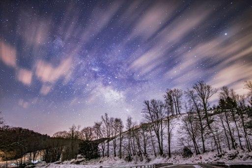 Snowy peaks beneath the Milky Way, just before sunrise in Sugar Grove, NC.