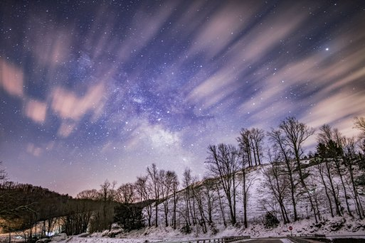 Snowy peaks beneath the Milky Way, just before sunrise in Sugar Grove, NC.