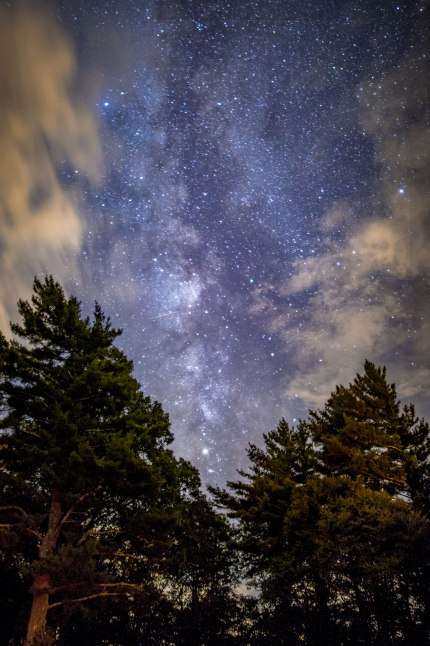 Milky Way shines between clouds along the Blue Ridge Parkway in North Carolina