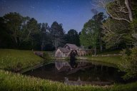 Mabry Mill and the stars above, captured at midnight. Mabry Mill started operation as a grist mill in 1905, and today serves as a scenic highlight of the Blue Ridge Parkway near Floyd, Virginia. I light painted the scene with a headlamp and light panel during a 30 second exposure.