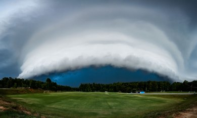 A severe warned storm approaches a soccer field in Greensboro, NC on 7/22/18. The shelf cloud was one of the best I have seen in North Carolina 27 image panorama